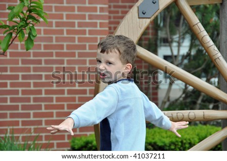 a little boy makes an angry face - stock photo