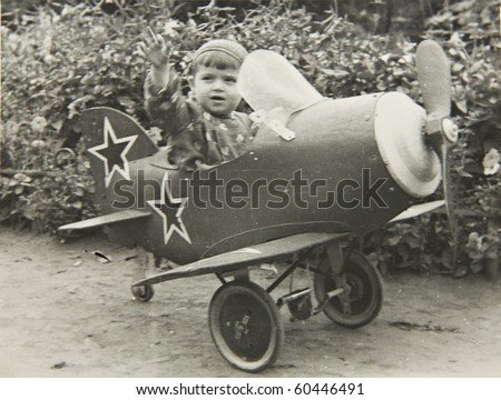 A little boy on the plane, an old picture of 40 years of XX century. - stock photo