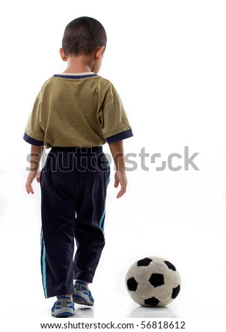 A little boy plays with soft ball on isolated background - stock photo