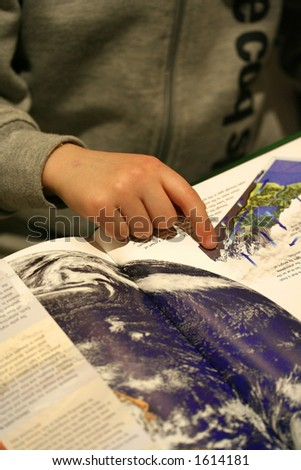 A little boy pointing and reading