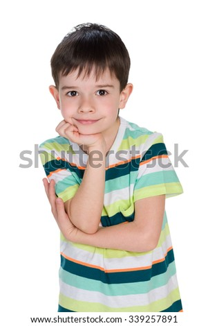 A little boy thinks on the white background - stock photo