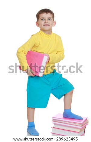 A little boy with a book in his hands - isolated on white background