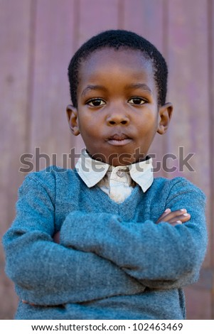 A little boy with a lot of confidence and big attitude - stock photo