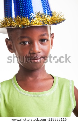 A little boy with a sparkling hat on the head. - stock photo
