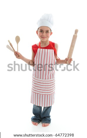 A little chef or cook holding wooden kitchen utensils.  White background. - stock photo