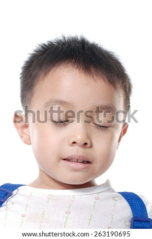 A little cute kid is thinking-white background - stock photo