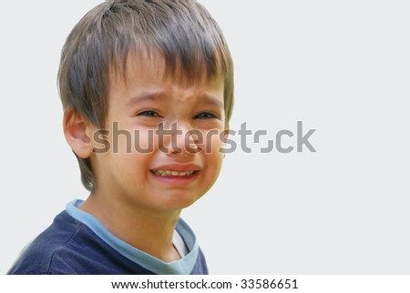 A little cute kid is truly crying and dropping big tears - stock photo