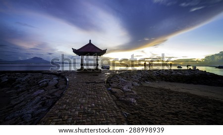 A little gazebo on the beach in early morning waiting for sunrise, photo taken in Bali. - stock photo