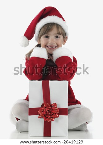 A little girl and xmas presents on white background - stock photo