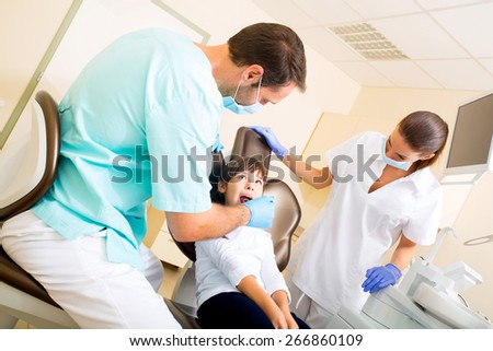 A little girl at the dentist during treatment.  - stock photo