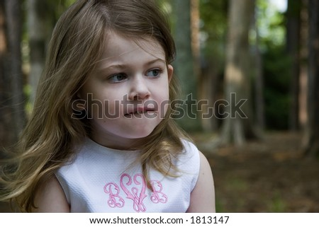 A Little Girl Biting Her Lip, Trying to Make a Decision