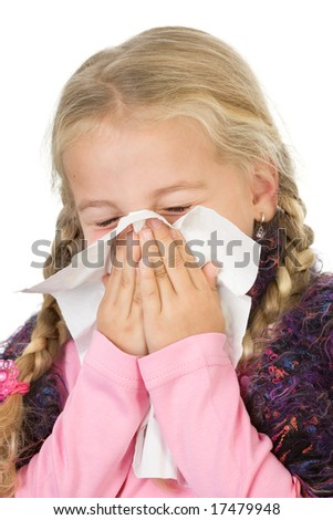 a little girl blowing her nose