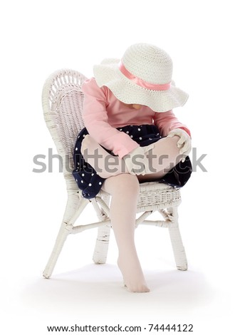 A Little Girl Bowing Her Head - stock photo