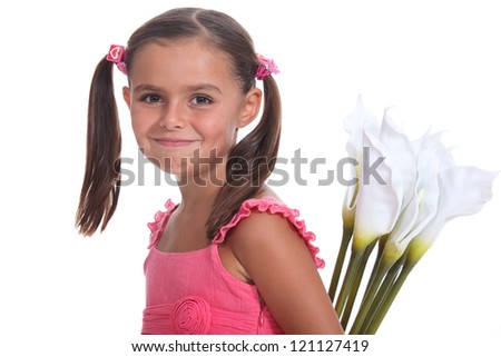 A little girl carrying lilies. - stock photo