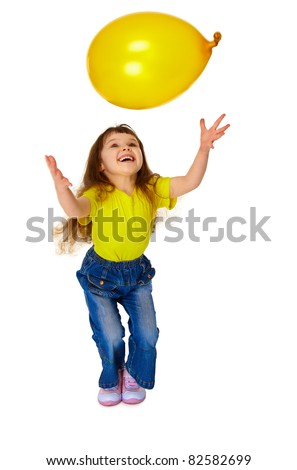 A little girl chasing balloon isolated on white background - stock photo
