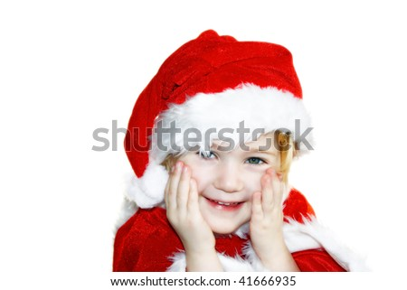 a little girl costumed as father christmas, smiling