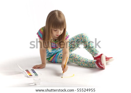 A little girl draws a painting - stock photo