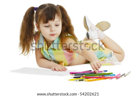 A little girl draws with crayons on a white background - stock photo