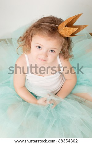 A little girl dressed elegantly played princess - stock photo