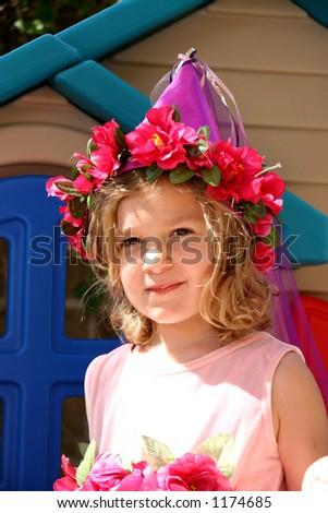 A little girl dressed up like a fairytale princess. - stock photo