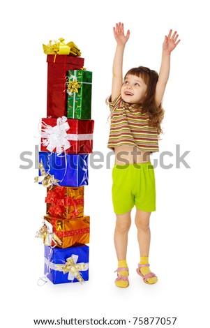 A little girl enjoys a birthday gift on white - stock photo