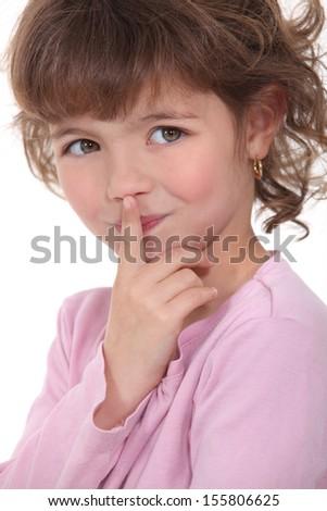 A little girl guarding a secret. - stock photo