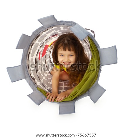 A little girl hiding inside the basket isolated on white background - stock photo