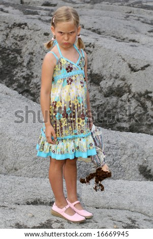 A little girl holding on to her doll. - stock photo