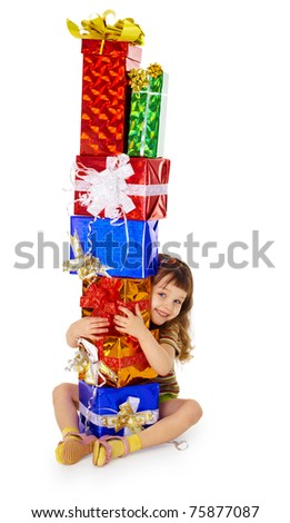A little girl hugs birthday gifts, isolated on a white background - stock photo