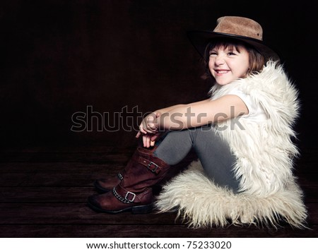 A little girl in a cow girl hat - stock photo