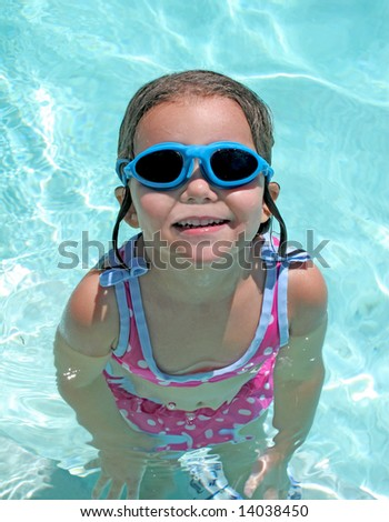 a little girl in goggles and swim suit - stock photo