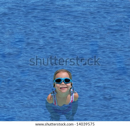 a little girl in goggles swimming in deep blue waters - stock photo