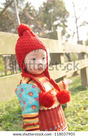 A little girl  in the backlight of the morning - stock photo