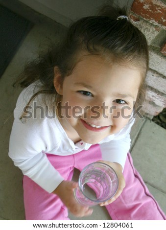 A little girl is happy to have fresh drinking water - stock photo