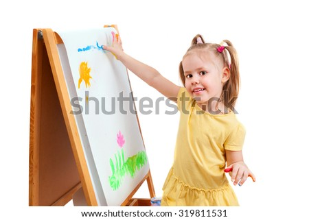 A little girl is paintig by fingers on white paper. isolated on white background. - stock photo