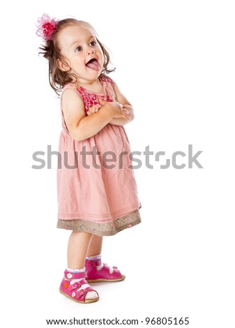 A little girl is posing. Isolated on a white background