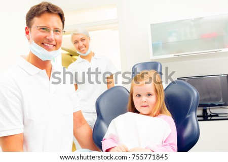 A little girl is seeing her dentist for a checkup