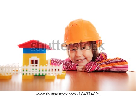 A little girl playing in the building. - stock photo