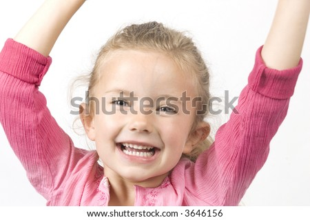 A little girl pulling a happy face - stock photo