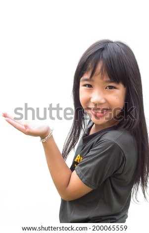 A little girl showing copy space isolated on white background - stock photo