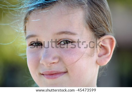 a little girl shows off her happy smile - stock photo