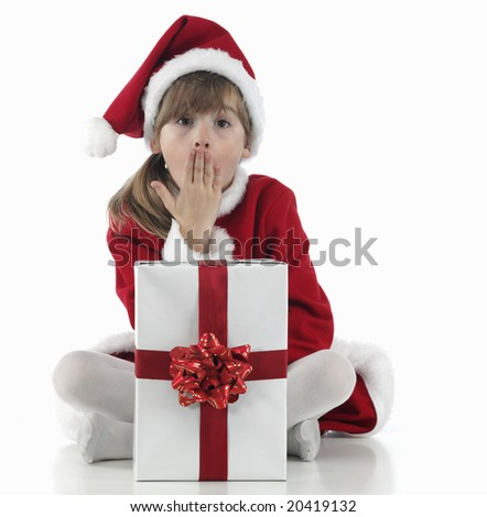 A little girl surpraised  and xmas presents on white background - stock photo