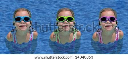 a little girl swimming in blue ocean waters - stock photo