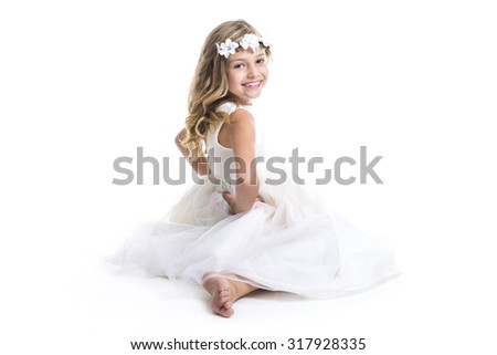 A Little girl wearing white dress on studio - stock photo