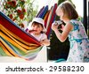 a little girl with a photo camera - stock photo