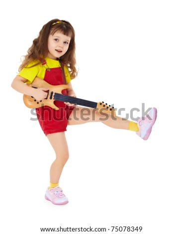 A little girl with a toy guitar isolated on white background - stock photo