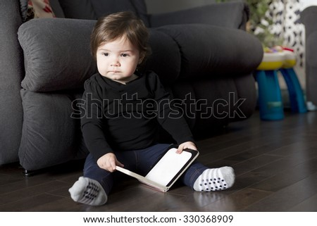 A Little girl with book on the living room