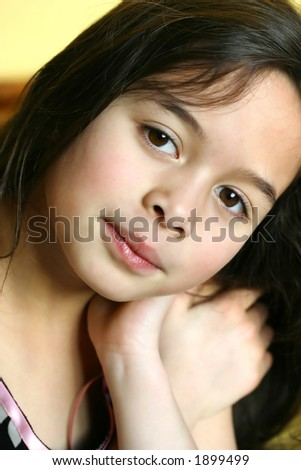 A little girl with brown eyes playing imaginary princess game. - stock photo