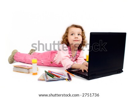 A little girl with computer, pencils, CD, school writing-materials around