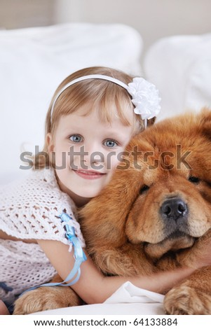 A little girl with the big dog - stock photo
